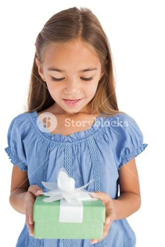 Cute little girl holding a wrapped gift