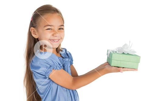 Cheerful little girl giving a present
