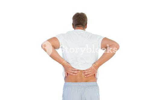 Muscled man suffering from back pain