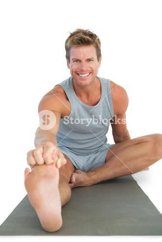 Cheerful man working out on the floor