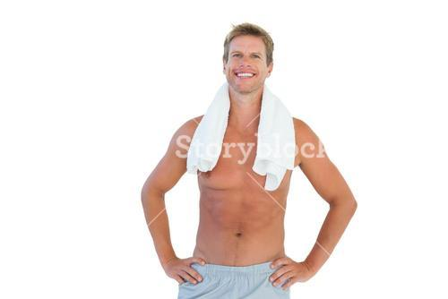 Cheerful man standing with hands on hips