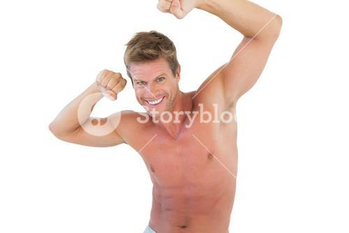 Smiling man flexing muscles