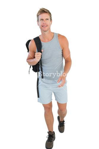 Handsome man walking and holding backpack
