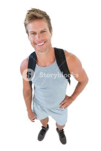 Attractive man in sportswear with hands on hips