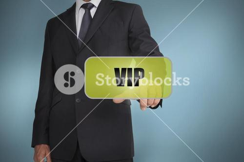 Businessman selecting green label with vip written on it