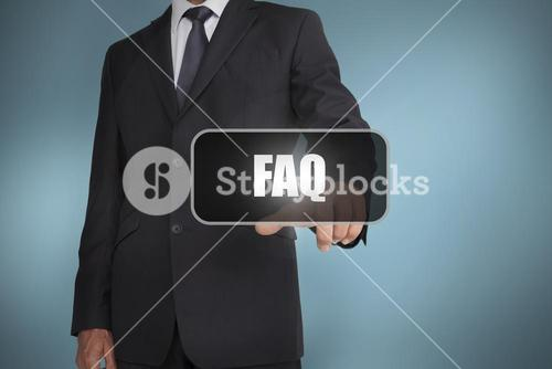Businessman touching the word faq