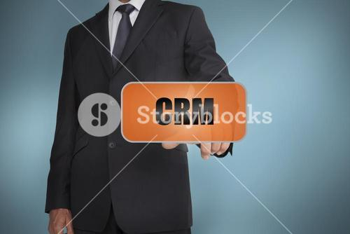 Businessman selecting orange tag with crm