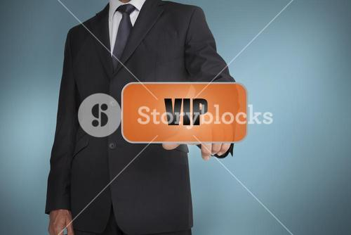 Businessman selecting orange tag with vip
