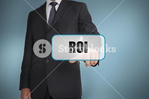 Businessman touching tag with roi written on it