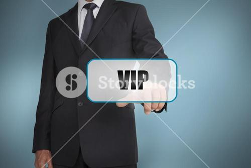 Businessman touching tag with vip written on it