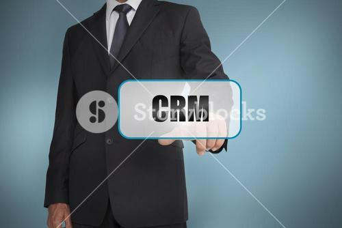Businessman touching tag with crm written on it