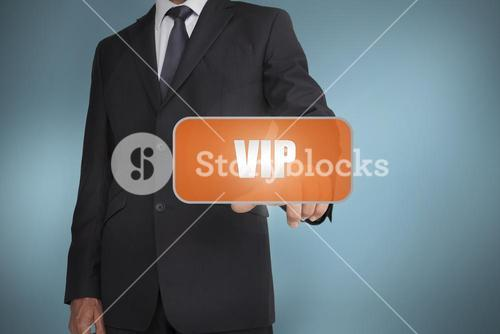 Businessman selecting orange tag with the word vip written on it