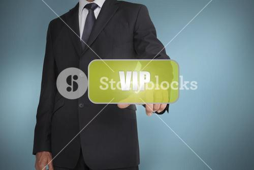 Businessman touching green tag with the word vip written on it