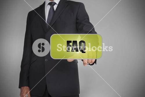 Businessman selecting green tag with the word faq written on it