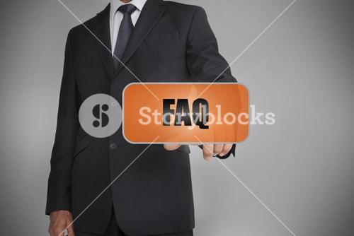 Businessman touching orange tag with the word faq written on it