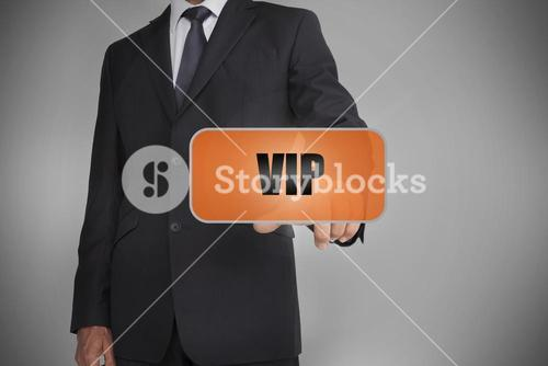 Businessman touching orange tag with the word vip written on it