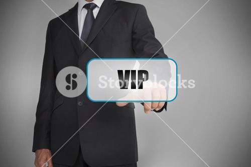 Businessman touching white tag with the word vip written on it