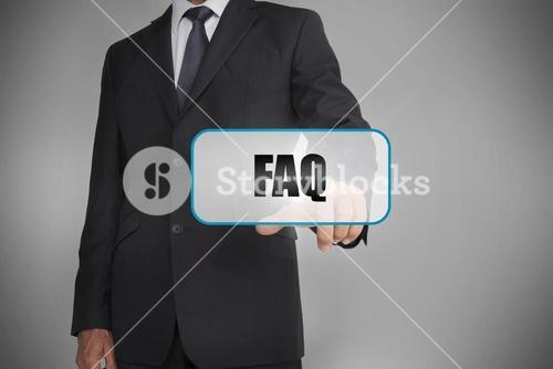 Businessman touching white tag with the word faq written on it