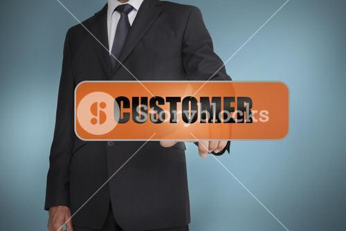 Businessman touching the word customer