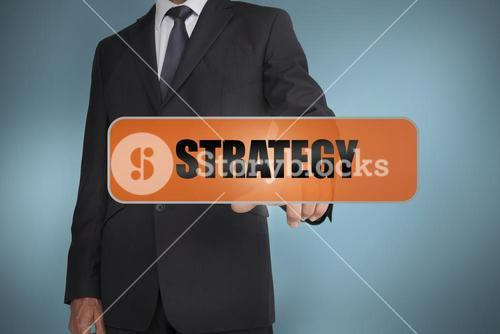 Businessman touching the word strategy