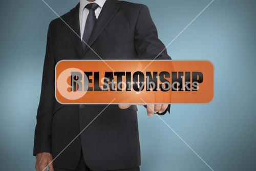 Businessman touching the word relationship
