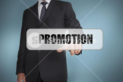 Businessman selecting the word promotion written on white tag