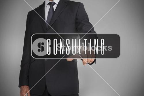 Businessman selecting the word consulting written on black tag