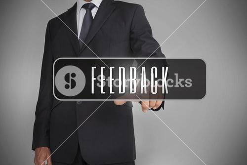 Businessman selecting label with feedback written on it