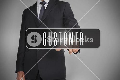 Businessman selecting label with customer written on it