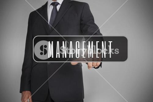 Businessman selecting label with management written on it
