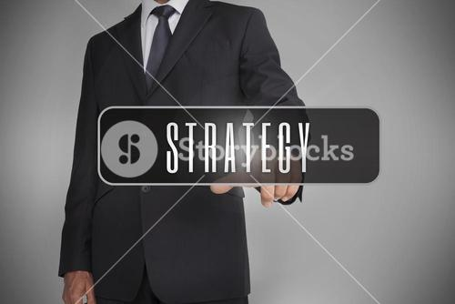 Businessman selecting label with strategy written on it