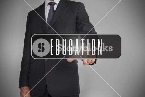 Businessman selecting label with education written on it