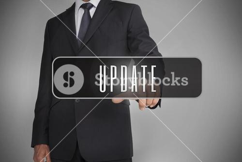 Businessman selecting label with update written on it
