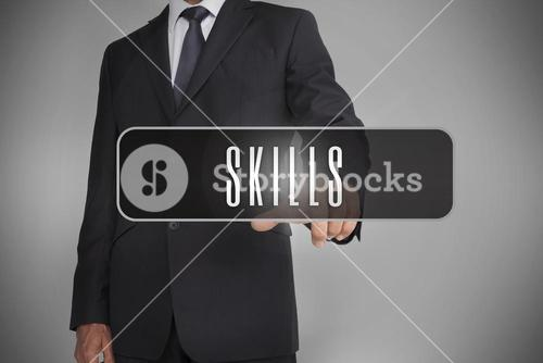 Businessman selecting label with skills written on it