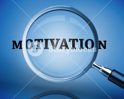 Magnifying glass showing motivation word