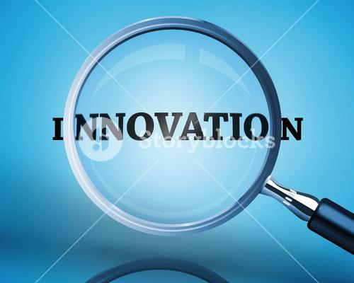 Magnifying glass showing innovation word