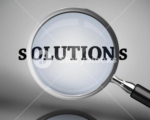 Magnifying glass showing solutions word