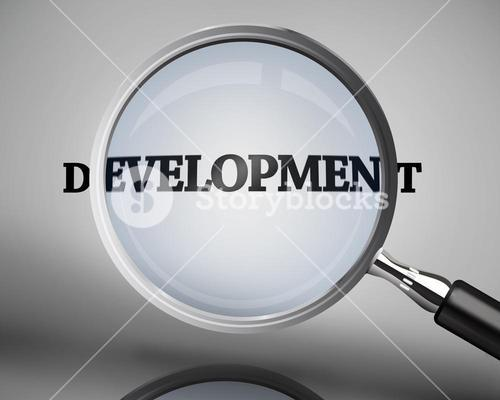 Magnifying glass showing development word