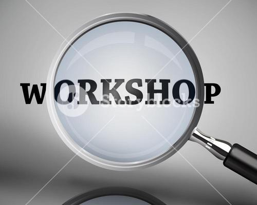 Magnifying glass showing workshop word