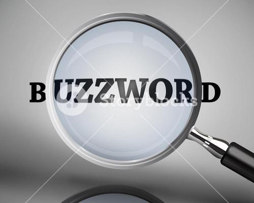 Magnifying glass showing buzzword word