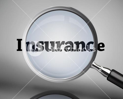Magnifying glass showing insurance word