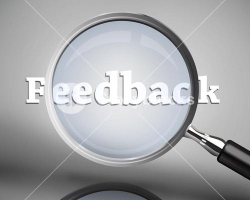 Magnifying glass showing feedback word in white
