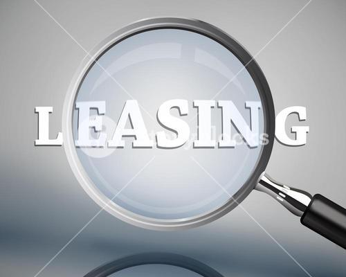Magnifying glass showing leasing word in white