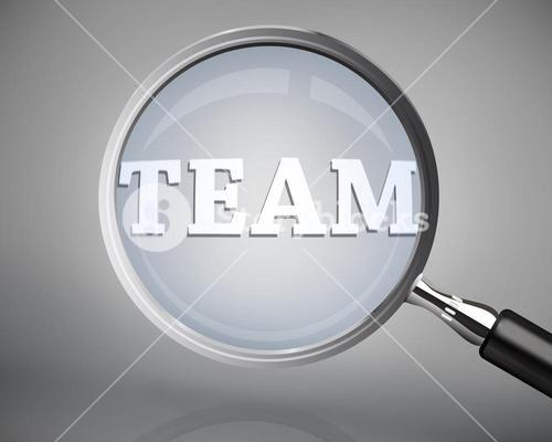 Magnifying glass showing team word in white
