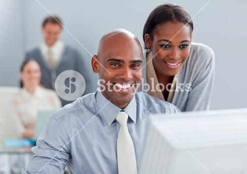 Portrait of two colleagues working at a computer