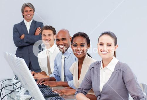 Happy customer service representatives in a callcenter