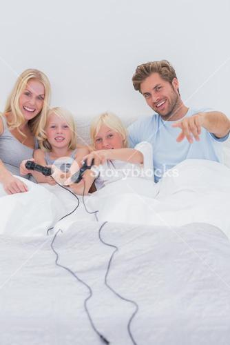 Cheerful family playing video games