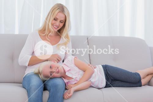 Mother taking care of her daughter