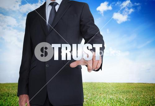 Businessman selecting trust word