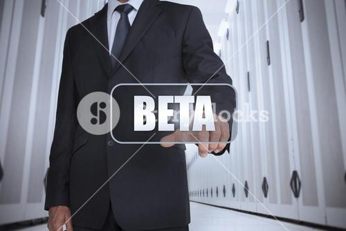 Businessman in a data center selecting label with beta